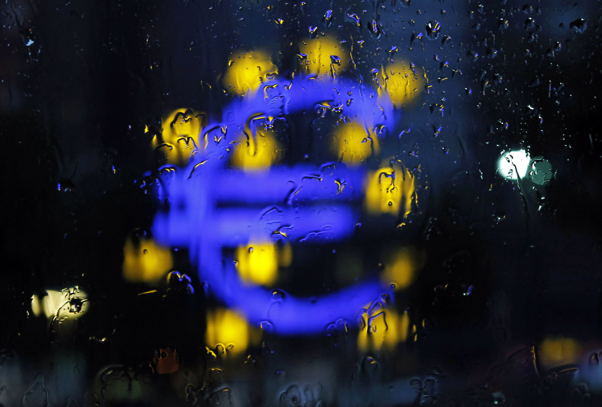 A structure of the Euro currency sign is seen through the window on a rainy evening in Frankfurt