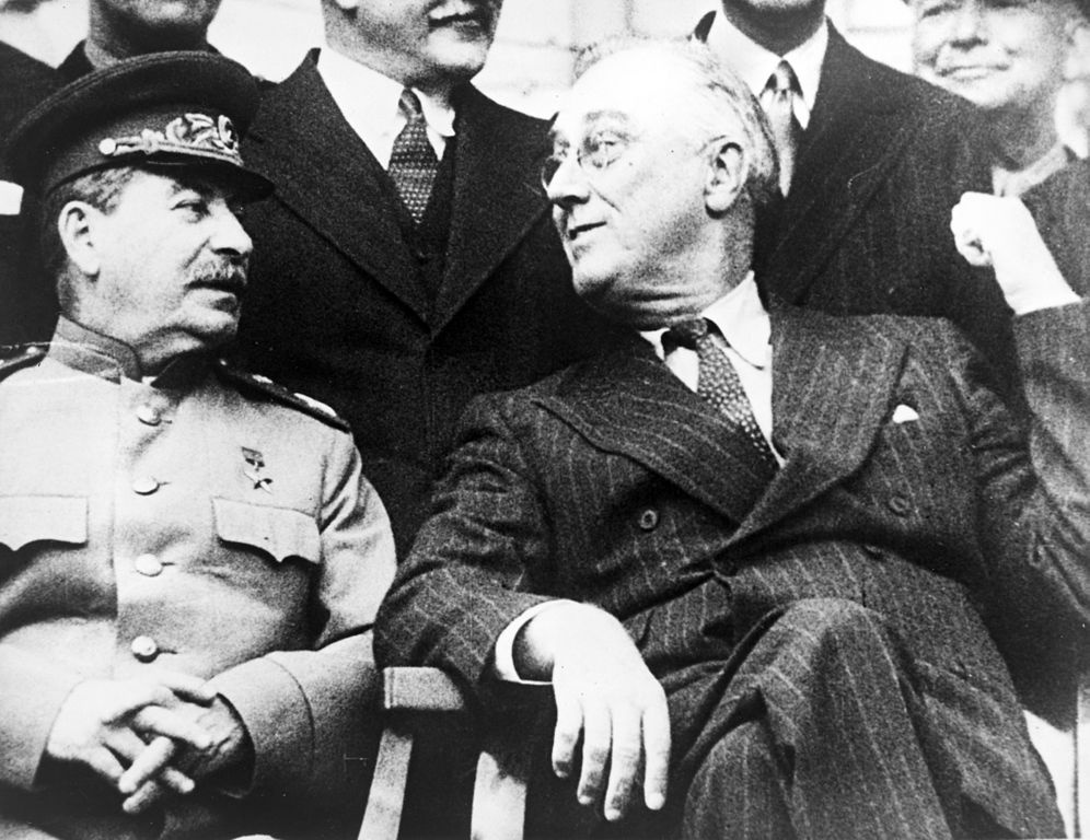 Joseph Stalin and Franklin Delano Roosevelt at the Tehran Conference. Wikimedia Commons/U.S. Army
