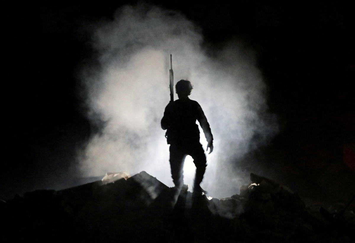 Turkey-backed Free Syrian Army fighter holds a weapon in the town of Tadef in Aleppo Governorate