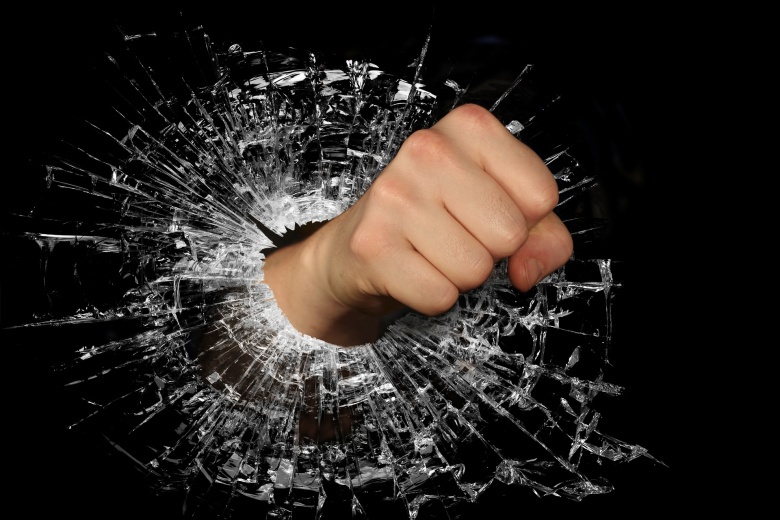 Image: A fist punching through glass. Stock photo, Pixabay, via WenPhotos. Public domain.
