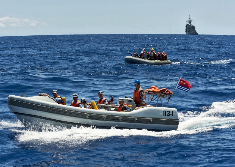 Chinese People's Liberation Army-Navy and U.S. Navy Sailors during a search and rescue exercise​. Flickr/U.S. Pacific Fleet