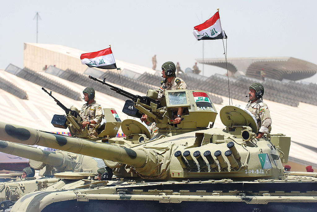 Iraqi security forces passing for review. Wikimedia Commons/U.S. Air Force