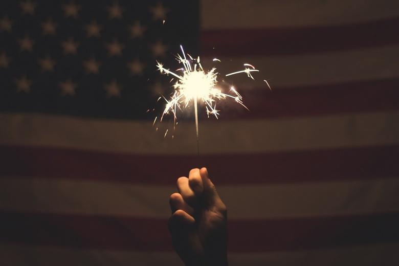 Sparkler before a U.S. flag. Pixabay/Public domain