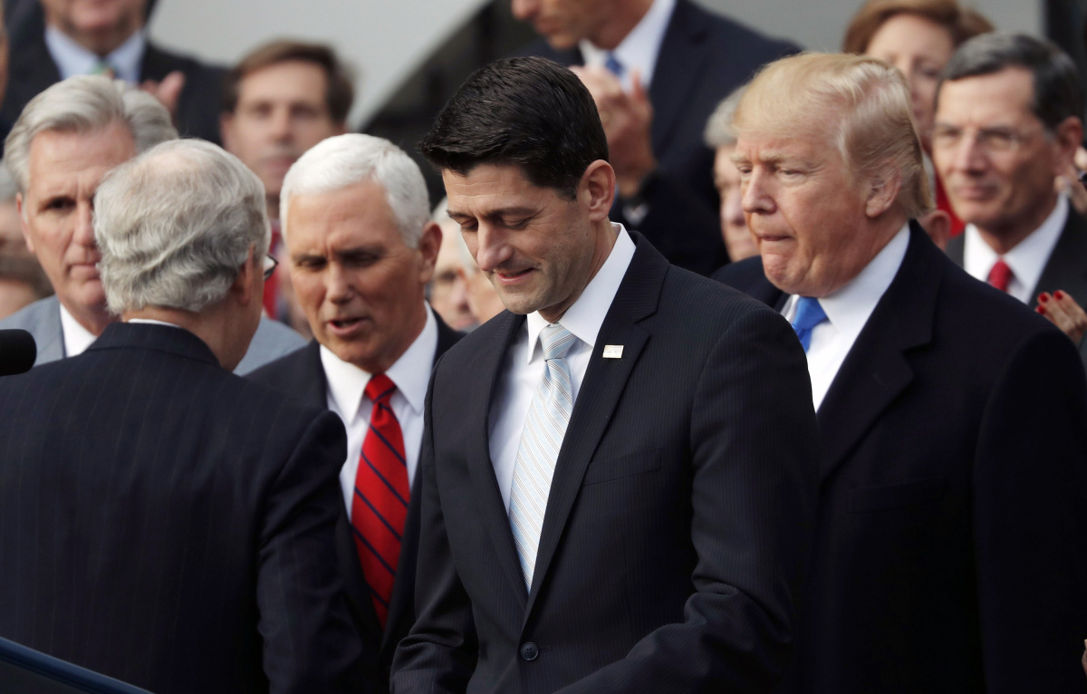 Speaker of the House Paul Ryan walks to the podium as he celebrates with Congressional Republicans after the U.S. Congress passed sweeping tax overhaul legislation