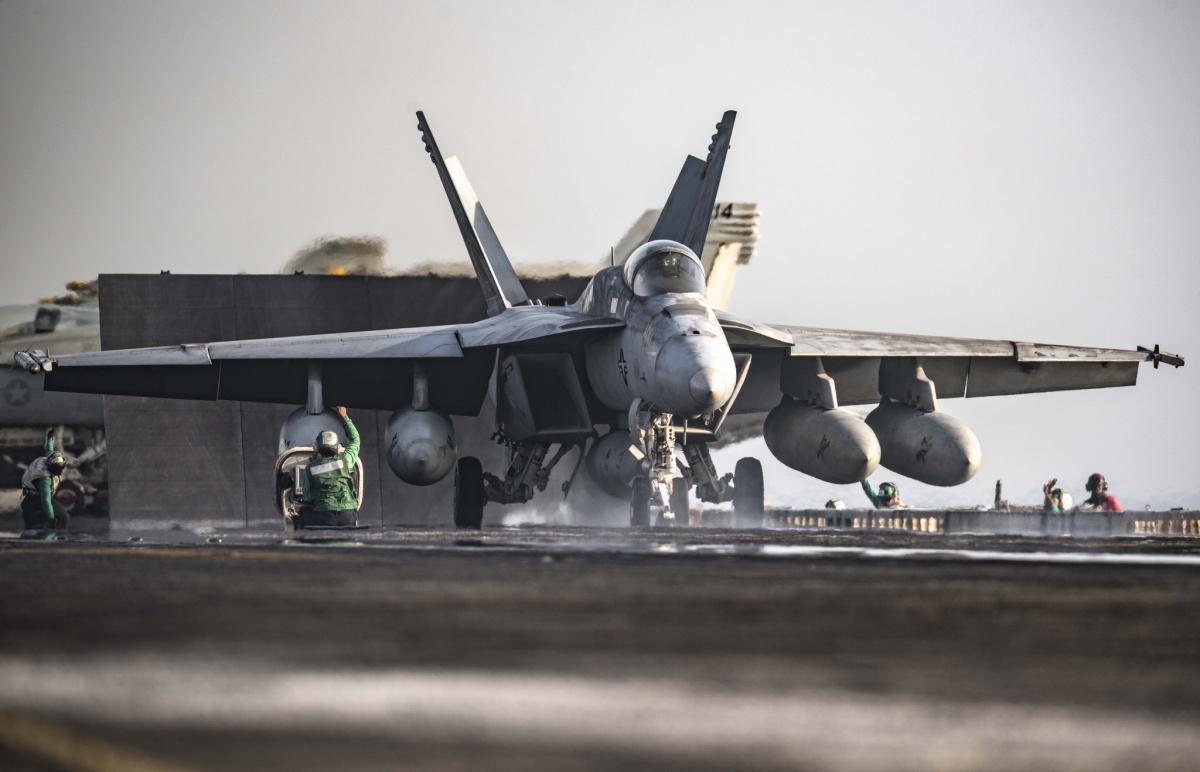 An F/A-18E Super Hornet launches from the flight deck of the aircraft carrier USS Dwight D. Eisenhower. Flickr/U.S. Navy