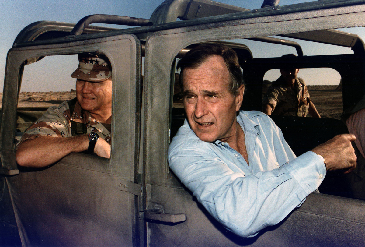President Bush rides in a HUMVEE with General H. Norman Schwarzkopf during his visit with troops in Saudi Arabia on Thanksgiving Day
