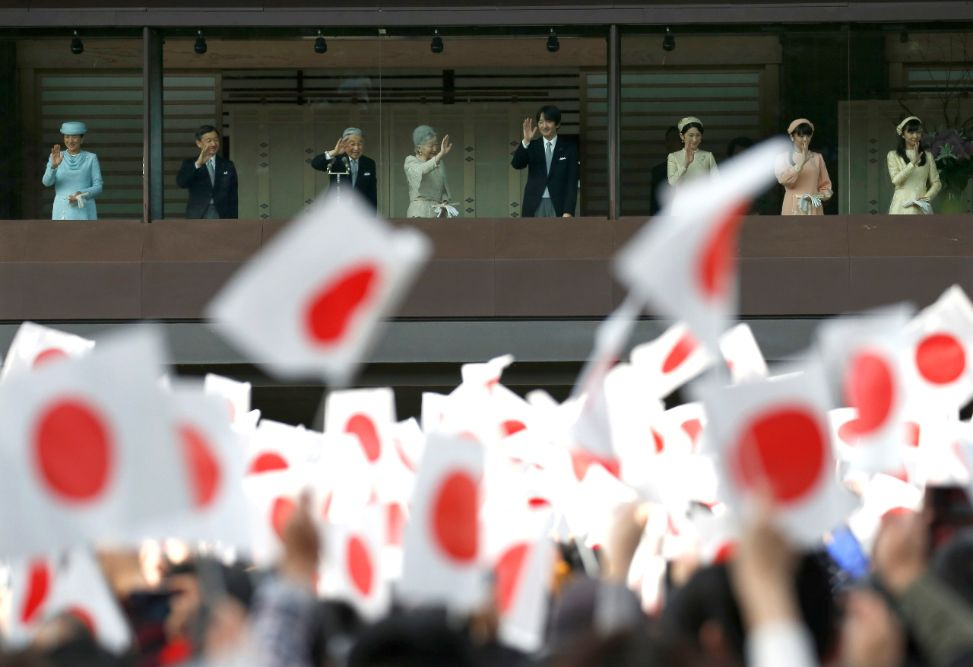 Japan's Emperor Akihito (3rd L), flanked by other members of the royal family, waves to well-wishers who gathered to celebrate his 83rd birthday at the Imperial Palace in Tokyo, Japan, December 23, 2016. Royal family members are (L-R) Crown Princess Masako, Crown Prince Naruhito, Emperor Akihito, Empress Michiko, Prince Akishino, and his wife Princess Kiko and their children Princess Mako and Princess Kako. REUTERS/Issei Kato