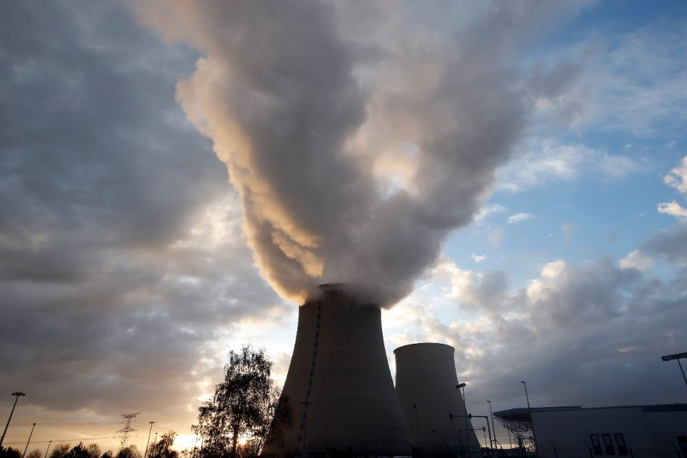 Steam rises at sunset from the cooling towers of the Electricite de France (EDF) nuclear power station at Nogent-Sur-Seine, France, November 13, 2015. The nuclear industry argues world leaders at the COP21 conference in Paris next week should not have to choose between nuclear and renewables but between low-carbon energy, including nuclear, and fossil fuels. Paris will host the World Climate Change Conference 2015 (COP21) from November 30 to December 11. Picture taken November 13, 2015. REUTERS/Charles Plat