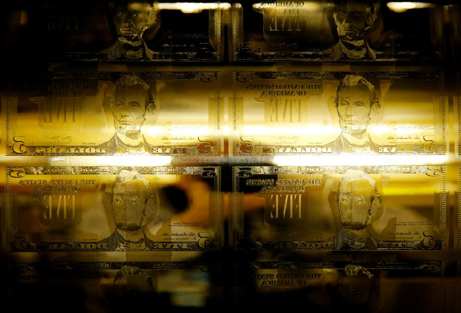 Engraving printing plates of former U.S. President Abraham Lincoln on the five-dollar bill currency are seen on a printing press at the Bureau of Engraving and Printing in Washington March 26, 2015. The 150th anniversary of Lincoln's assassination at Ford's Theatre in Washington is April 15. REUTERS/Gary Cameron