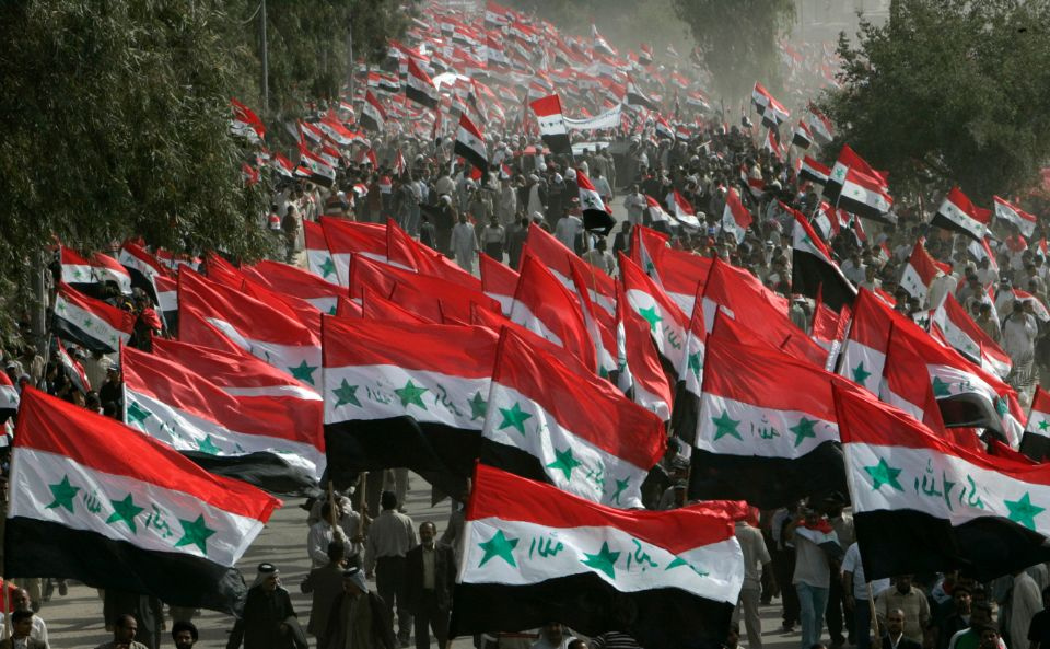 Demonstrators wave Iraqi flags during an anti-U.S. protest called by fiery cleric Moqtada al-Sadr in Najaf, marking the fourth anniversary of the fall of Baghdad April 9, 2007. Baghdad was under curfew on Monday on the fourth anniversary of the fall of the capital to U.S. forces. REUTERS/Ceerwan Aziz