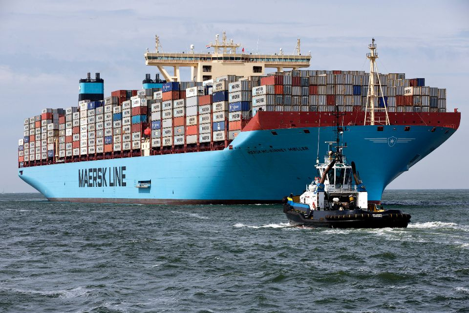 The MV Maersk Mc-Kinney Moller, the world's biggest container ship, arrives at the harbour of Rotterdam August 16, 2013. The 55,000 tonne ship, named after the son of the founder of the oil and shipping group A.P. Moller-Maersk, has a length of 400 meters and cost $185 million. A.P. Moller-Maersk raised its annual profit forecast for the business on Friday, helped by tighter cost controls and lower fuel prices. Maersk shares jumped 6 percent to their highest in 1-1/2 years as investors welcomed a near-doubl