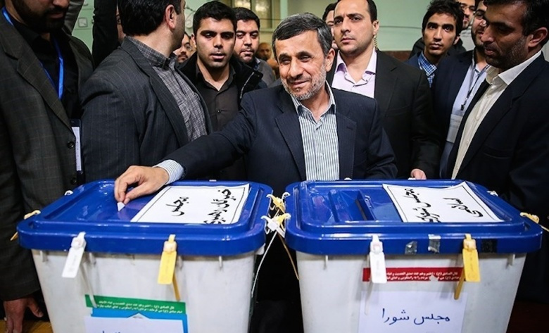 Mahmoud Ahmadinejad casting his vote in Iran's 2016 election​. Wikimedia Commons/Hamed Malekpour