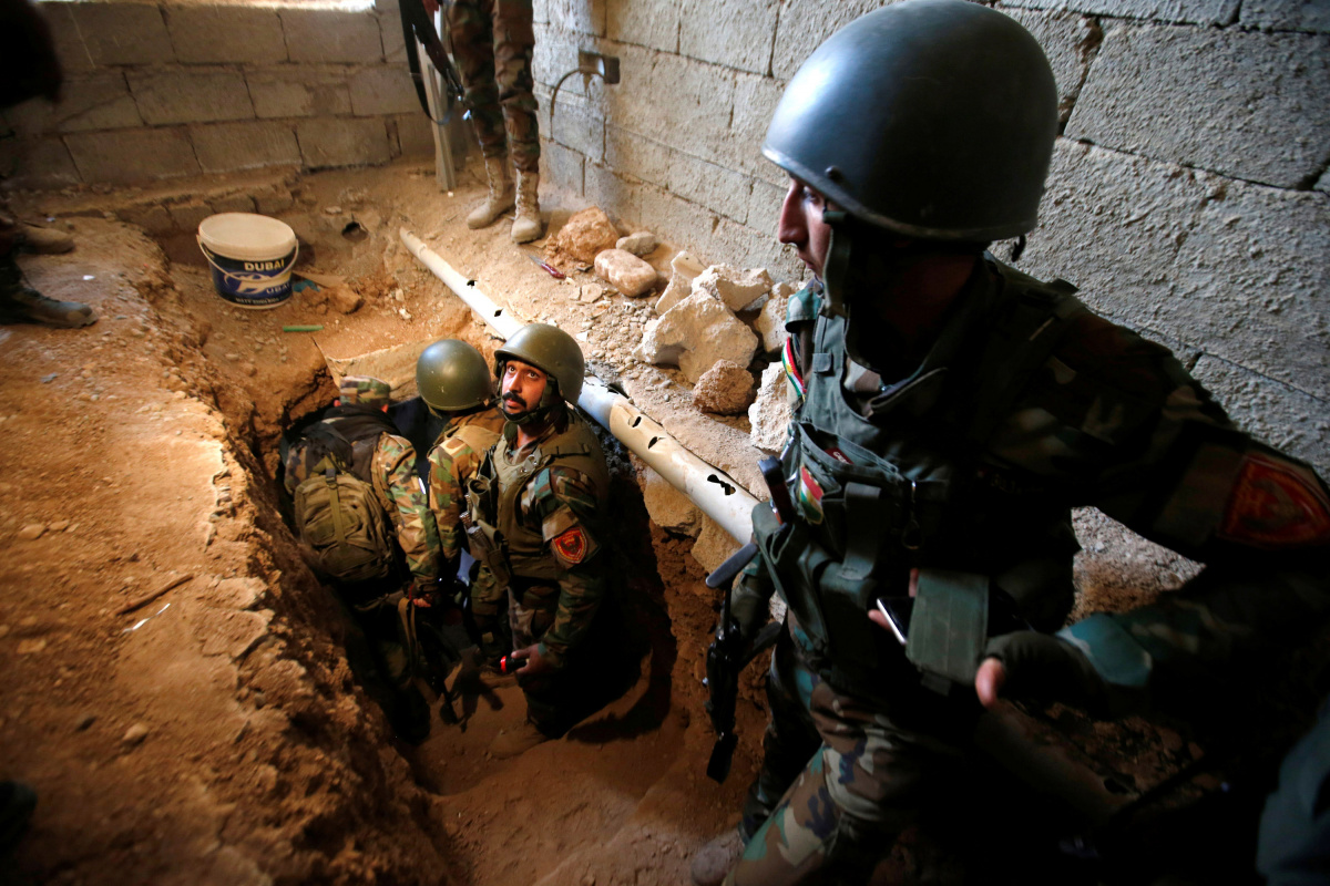 Peshmerga forces inspect a tunnel used by Islamic State militants in the town of Bashiqa, after it was recaptured from the Islamic State, east of Mosul, Iraq