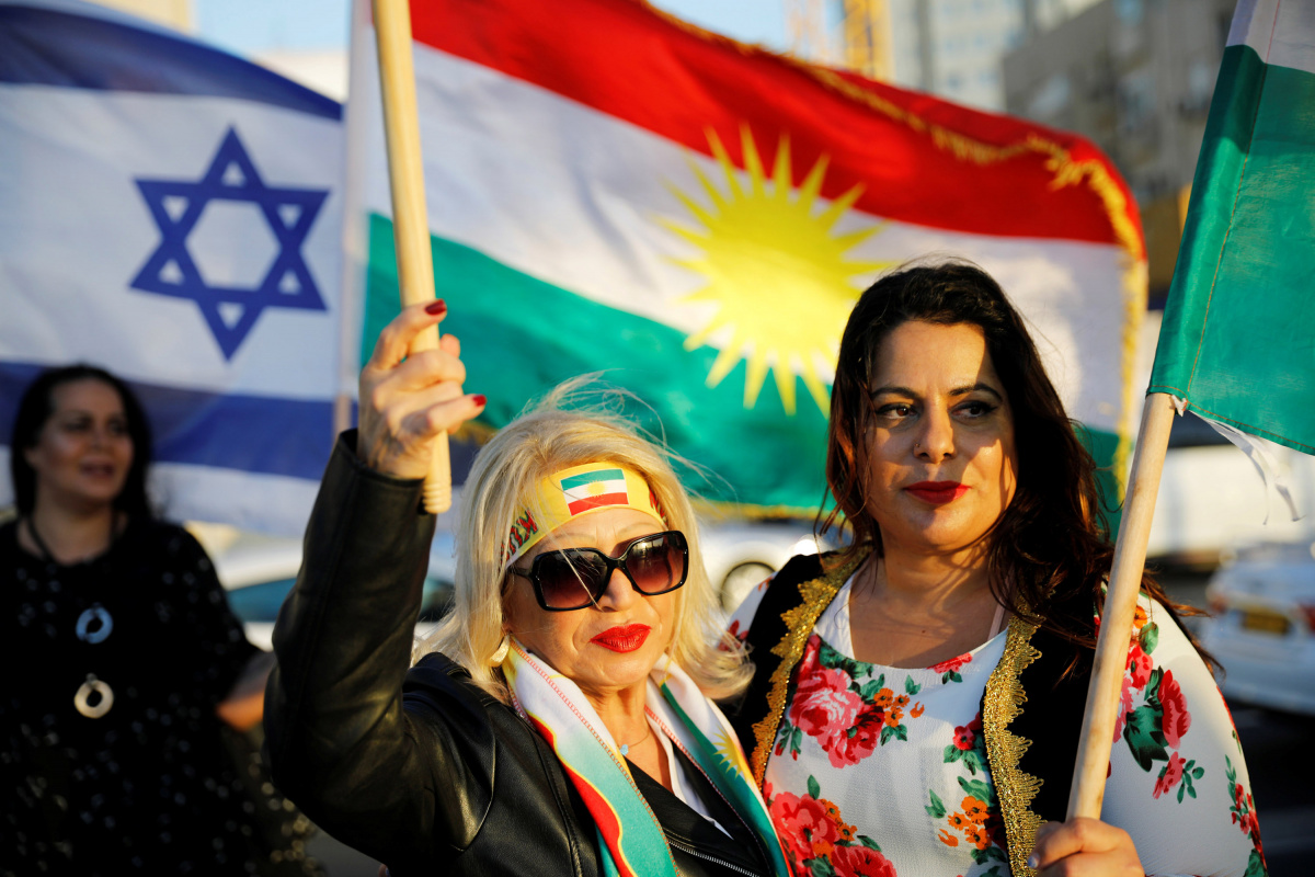 Israelis mainly of Kurdish origin take part in a gathering outside the American embassy in Tel Aviv, Israel