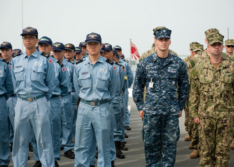 U.S. Navy and Japan Maritime Self-Defense Force sailors stand in formation. Flickr/U.S. Navy