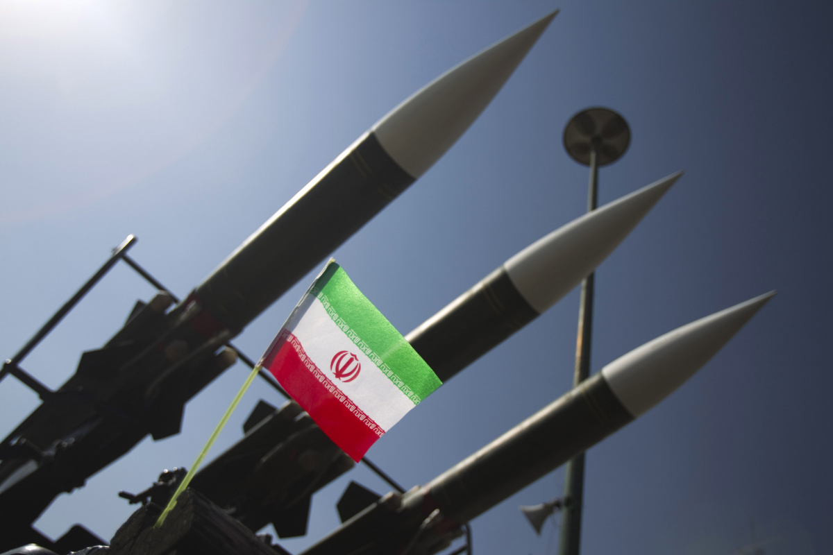 """An Iranian flag is pictured next to Russian-made Sam-6 surface-to-air missiles during a war exhibition held by Iran's revolutionary guard to mark the anniversary of the Iran-Iraq war (1980-88), also known in Iran as the """"Holy Defence"""", at Baharestan square near the Iranian Parliament in southern Tehran"""