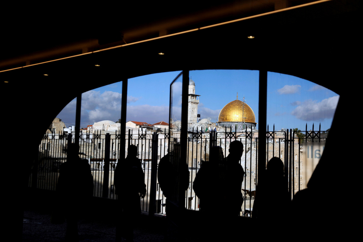 People look out from a building facing the Dome of the Rock, located in Jerusalem's Old City on the compound known to Muslims as Noble Sanctuary and to Jews as Temple Mount