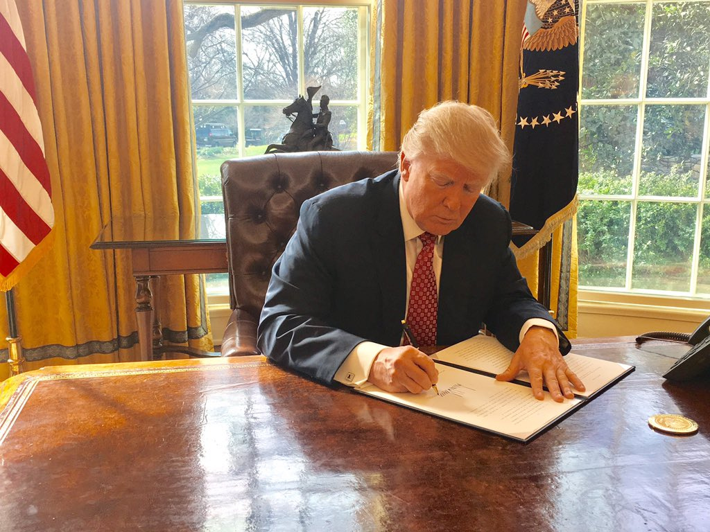 Donald Trump signing Executive Order 13780. Wikimedia Commons/Sean Spicer