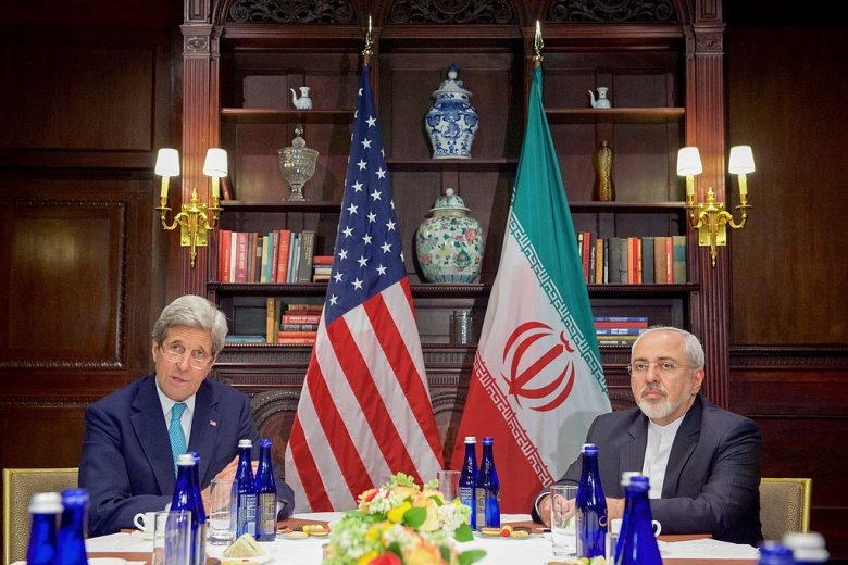 John Kerry addresses reporters before a bilateral meeting with Iranian foreign minister Javad Zarif. Wikimedia Commons/Department of State