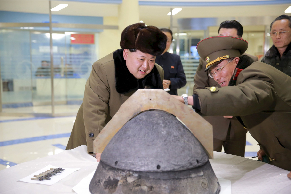 North Korean leader Kim Jong Un looks at a rocket warhead tip after a simulated test of atmospheric re-entry of a ballistic missile, at an unidentified location in this undated file photo released by North Korea's Korean Central News Agency (KCNA) in Pyongyang on March 15, 2016. REUTERS/KCNA/Files ATTENTION EDITORS - THIS PICTURE WAS PROVIDED BY A THIRD PARTY. REUTERS IS UNABLE TO INDEPENDENTLY VERIFY THE AUTHENTICITY, CONTENT, LOCATION OR DATE OF THIS IMAGE. FOR EDITORIAL USE ONLY. NOT FOR SALE FOR MARKETI
