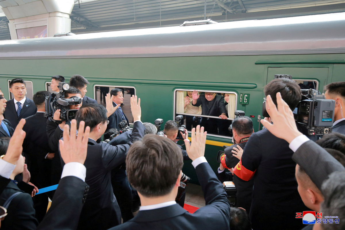North Korean leader Kim Jong Un waves from a train as he paid an unofficial visit to China