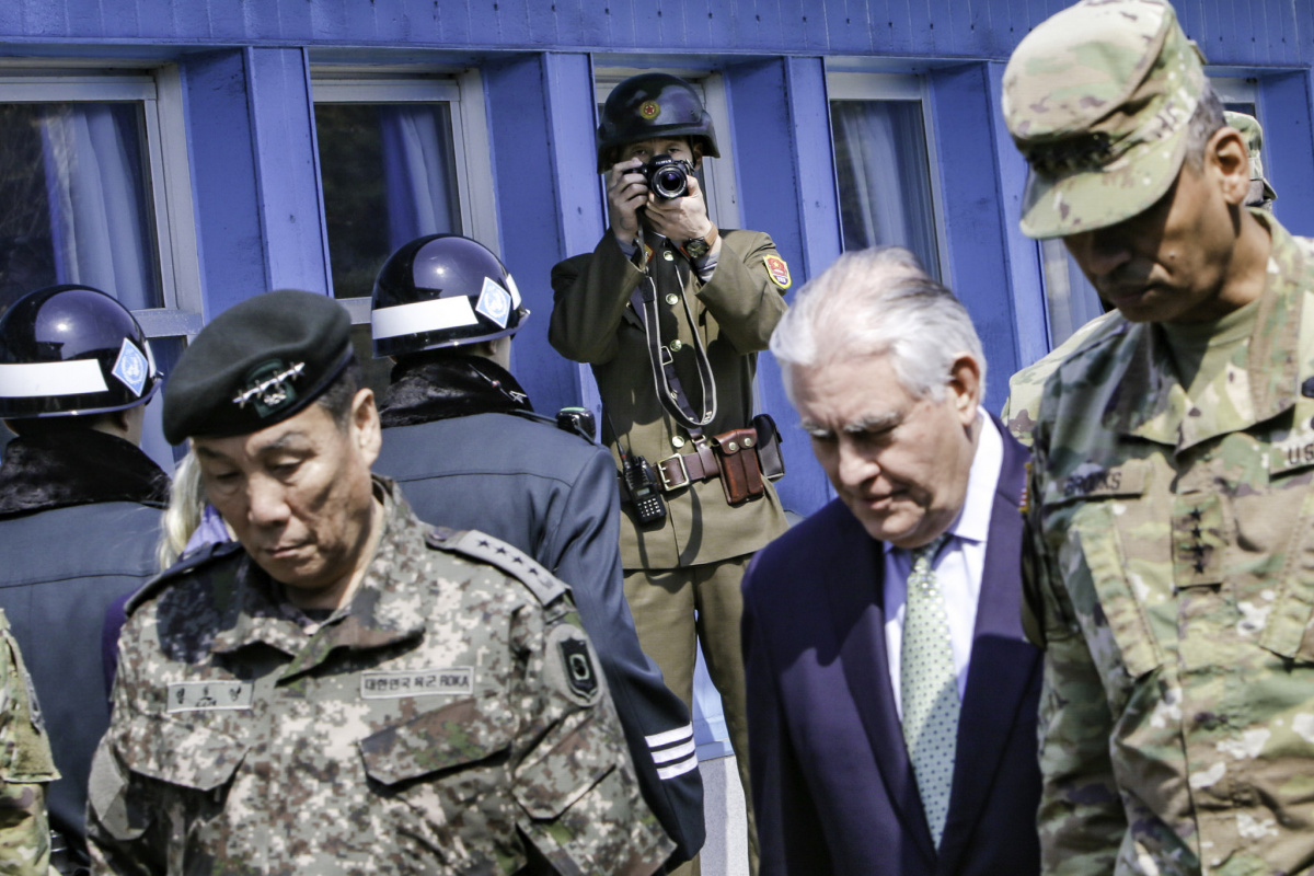 A North Korean People's Army service member photographs Rex Tillerson at the Korean border. Flickr/U.S. Forces Korea