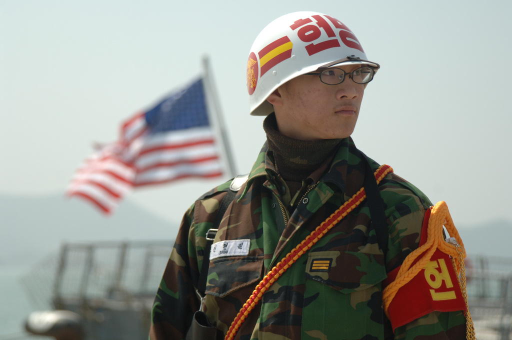 Petty Officer 3rd Class Hyun-gili Shin guards USS Paul Hamilton in Mokpo, Republic of Korea. Flickr/U.S. Navy photo