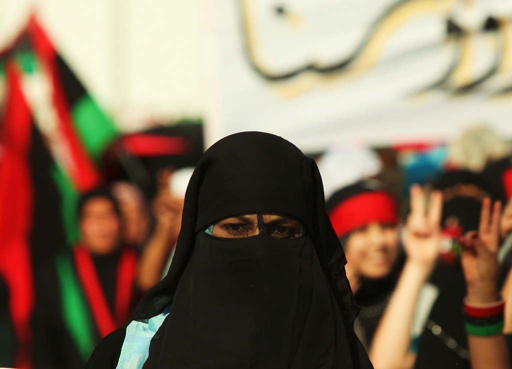 Libyan girl wearing a niqab during demonstrations in Bayda, Libya. Wikimedia Commons/Public domain