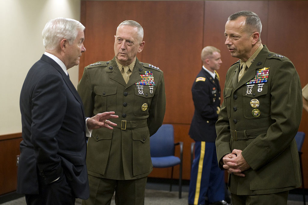 Secretary of Defense Robert M. Gates speaks with Lt. Gen. John Allen and Gen. James N. Mattis. Wikimedia Commons/Public domain