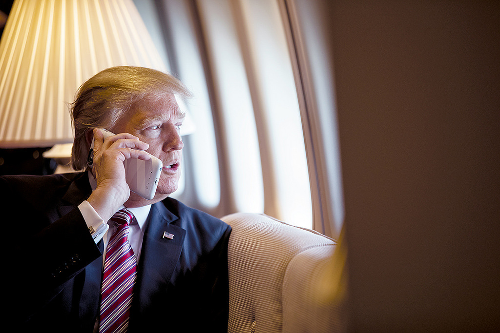 President Donald Trump talks on the phone aboard Air Force One. Flickr/The White House
