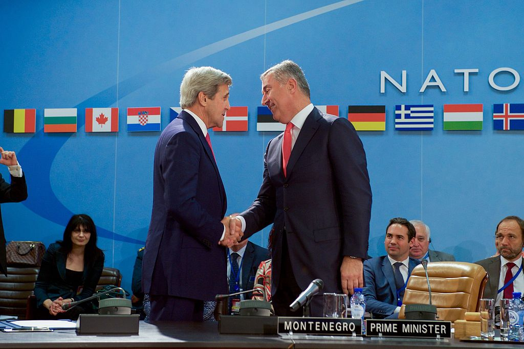 U.S. Secretary of State John Kerry shakes hands with Montenegrin Prime Minister Milo Djukanovic. Wikimedia Commons/Department of State