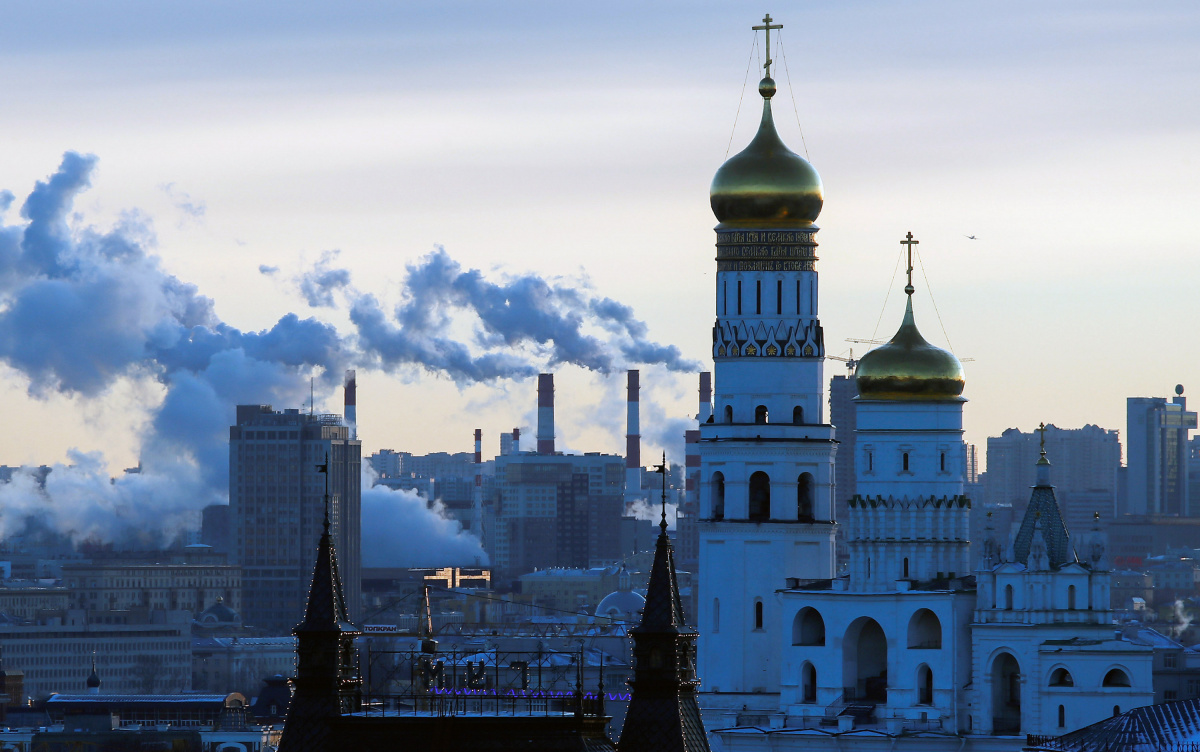 Steam rises from the chimneys of a thermal power plant behind the Ivan the Great Bell Tower in Moscow