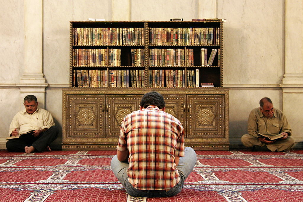 Men reading the Koran in the Umayyad Mosque, Damascus, Syria. Wikimedia Commons/Creative Commons/Erik Albers