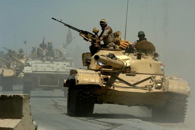 Iraqi T-72 tanks pass through a highway checkpoint in Mushahada, Iraq on their way to Forward Operating Base Camp Taji, Iraq. Wikimedia Commons/U.S. Navy
