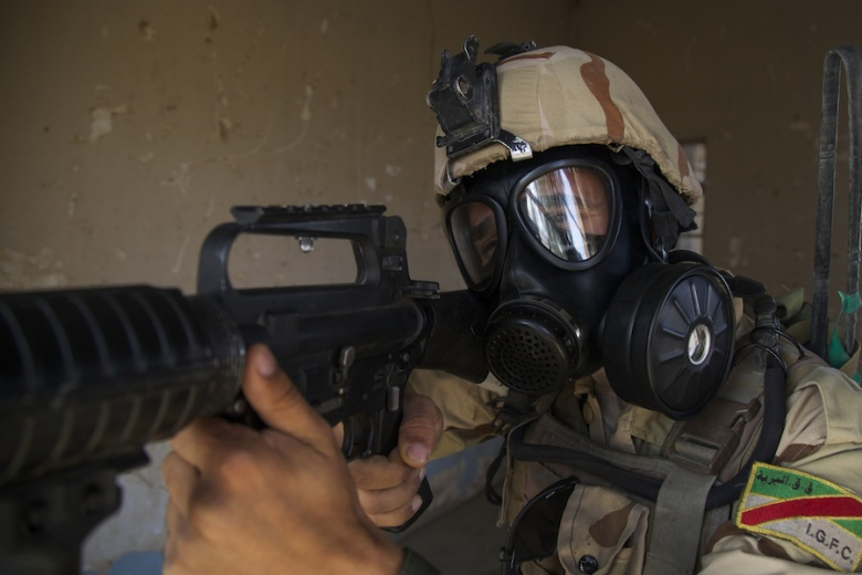 An Iraqi soldier attending the advanced infantry course provides security during chemical, biological, radiological and nuclear defense training at Camp Taji, Iraq. DVIDSHUB/Public domain