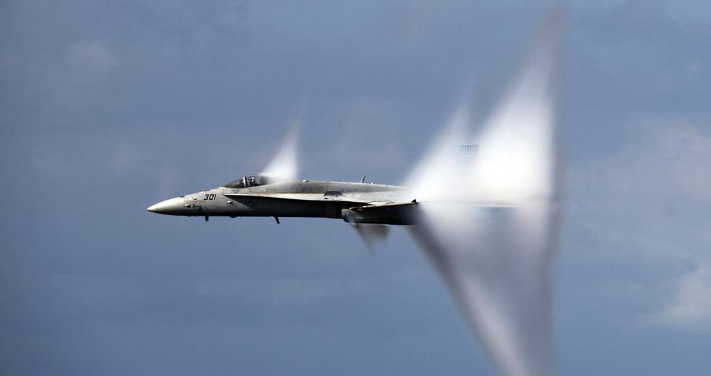 An F/A-18C Hornet breaks the sound barrier during an air power demonstration. Flickr/U.S. Navy