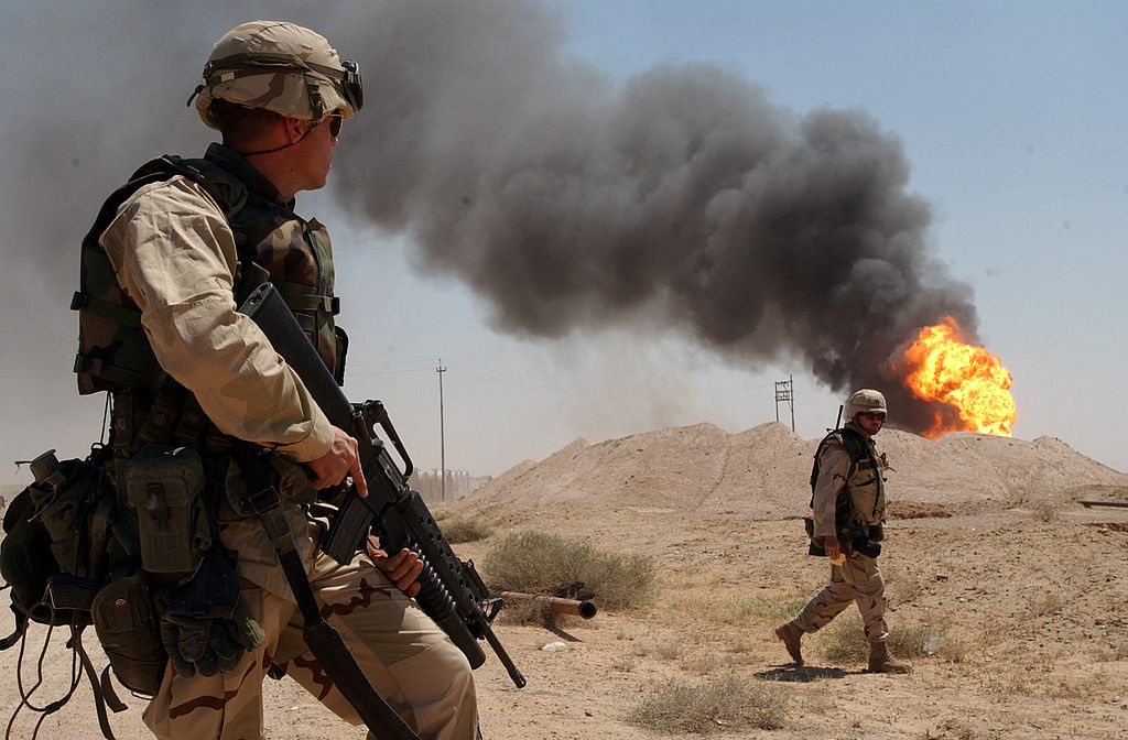 A burning oil well in the Rumaylah Oil Fields in southern Iraq. Wikimedia Commons/U.S. Navy