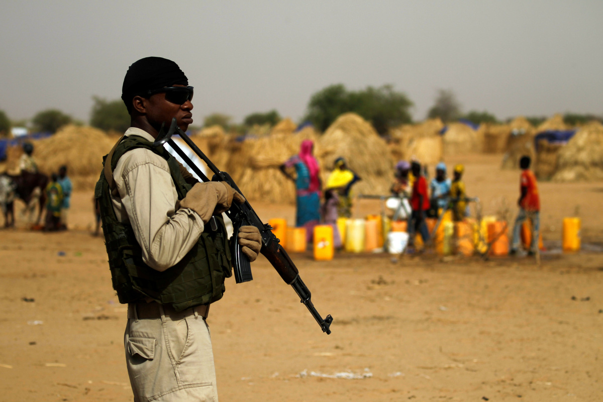 A Nigerien soldier stands guard in a camp of the city of Diffa during the visit of Niger's Interior Minister Mohamed Bazoum following attacks by Boko Haram fighters in the region of Diffa, Niger