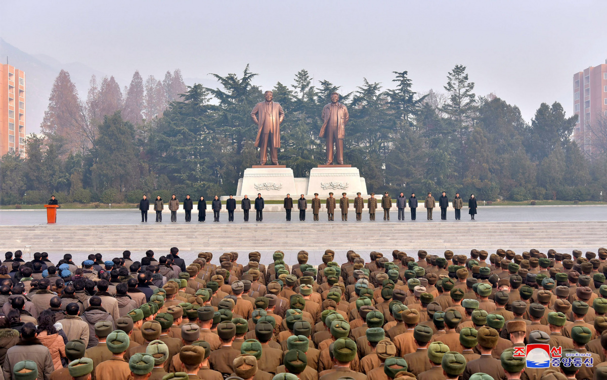 Civilians and members of the army attend one of the joint meetings, that were held across South Phyongan, Hwanghae and Hamgyong provinces, to celebrate North Korea's nuclear progress in this photo released by KCNA