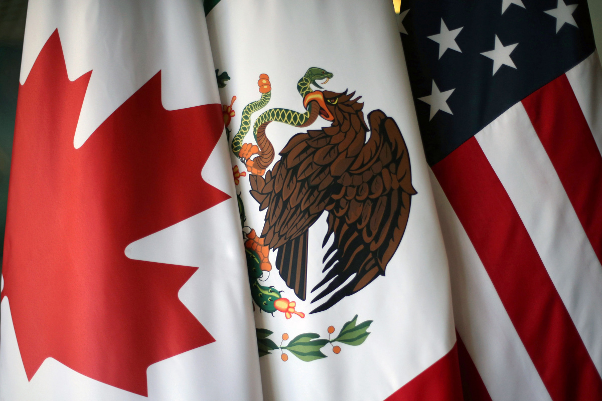 Flags are pictured during the fifth round of NAFTA talks involving the United States, Mexico and Canada, in Mexico City