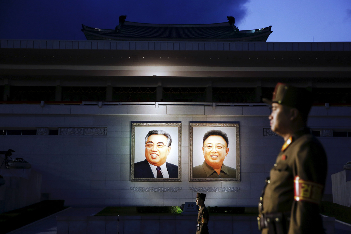Soldiers guard a grand stand decorated with portraits of North Korea's founder Kim Il-sung (L) and former leader Kim Jong-il after the parade celebrating the 70th anniversary of the founding of the ruling Workers' Party of Korea, in Pyongyang