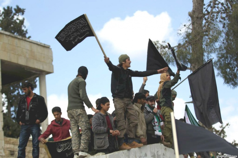 Al-Nusra Front members and a Free Syrian Army commander in Maarrat al-Nu'man, 11 March 2016. Wikimedia Commons/Voice of America