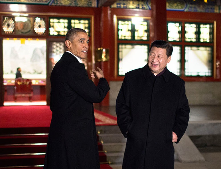 President Barack Obama gestures as he and President Xi Jinping of China arrive for a bilateral meeting at Zhong Nan Hai in Beijing. Flickr/The White House