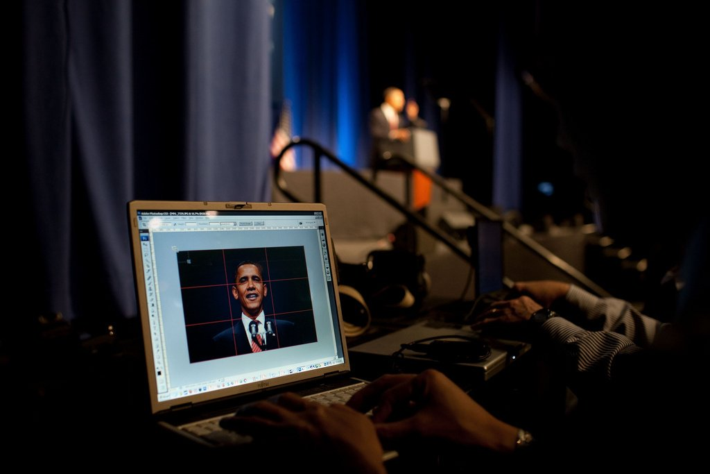 A photo of President Barack Obama appears on a photographer's computer. Flickr/The White House