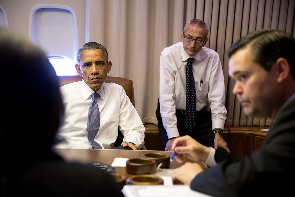 President Barack Obama holds a meeting aboard Air Force One. Flickr/The White House