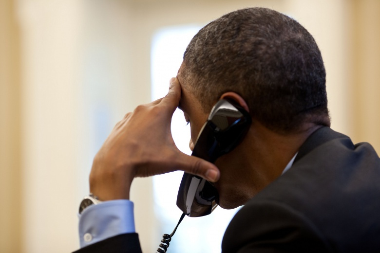 President Barack Obama talks on the phone in the Oval Office. Flickr/The White House