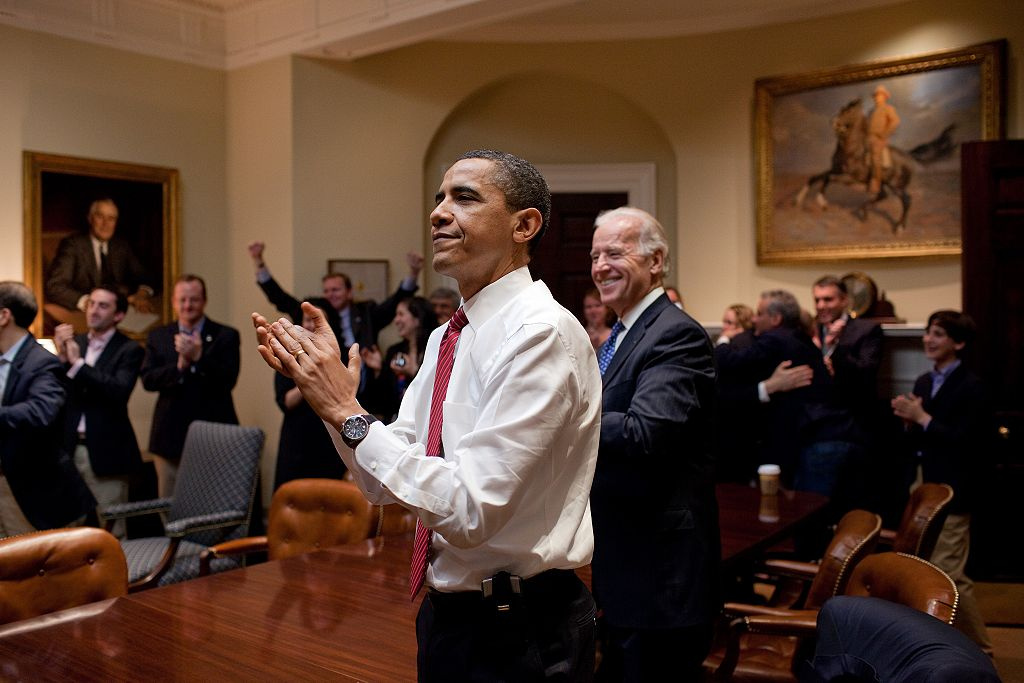 President Barack Obama, Vice President Joe Biden, and senior staff react as the House passes the health care reform bill. Wikimedia Commons/The White House