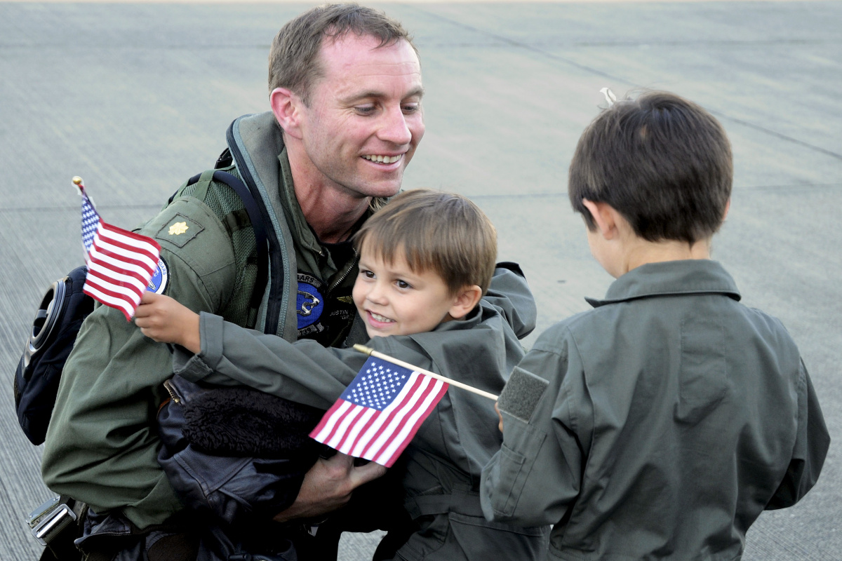 Lt. Cmdr. Justin Griffin is greeted by family members during a homecoming ceremony following a seven month deployment aboard the USS Ronald Reagan. Department of Defense