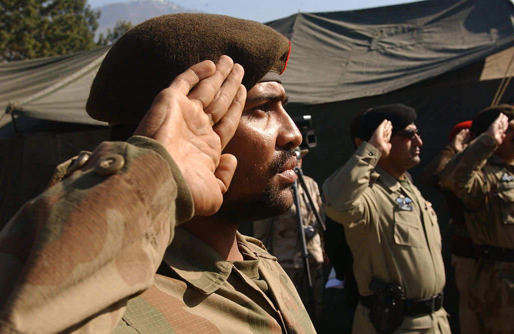 Pakistan army soldiers salute during a transfer of authority ceremony with U.S. Army soldiers in Muzaffarabad, Pakistan. Wikimedia Commons/Defense.gov