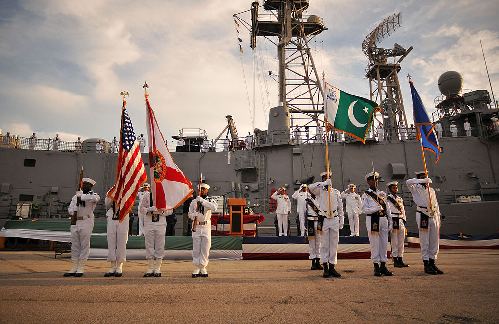 U.S. and Pakistani flags at decommissioning ceremony of the guided-missile frigate USS McInerney. Wikimedia Commons/U.S. Navy